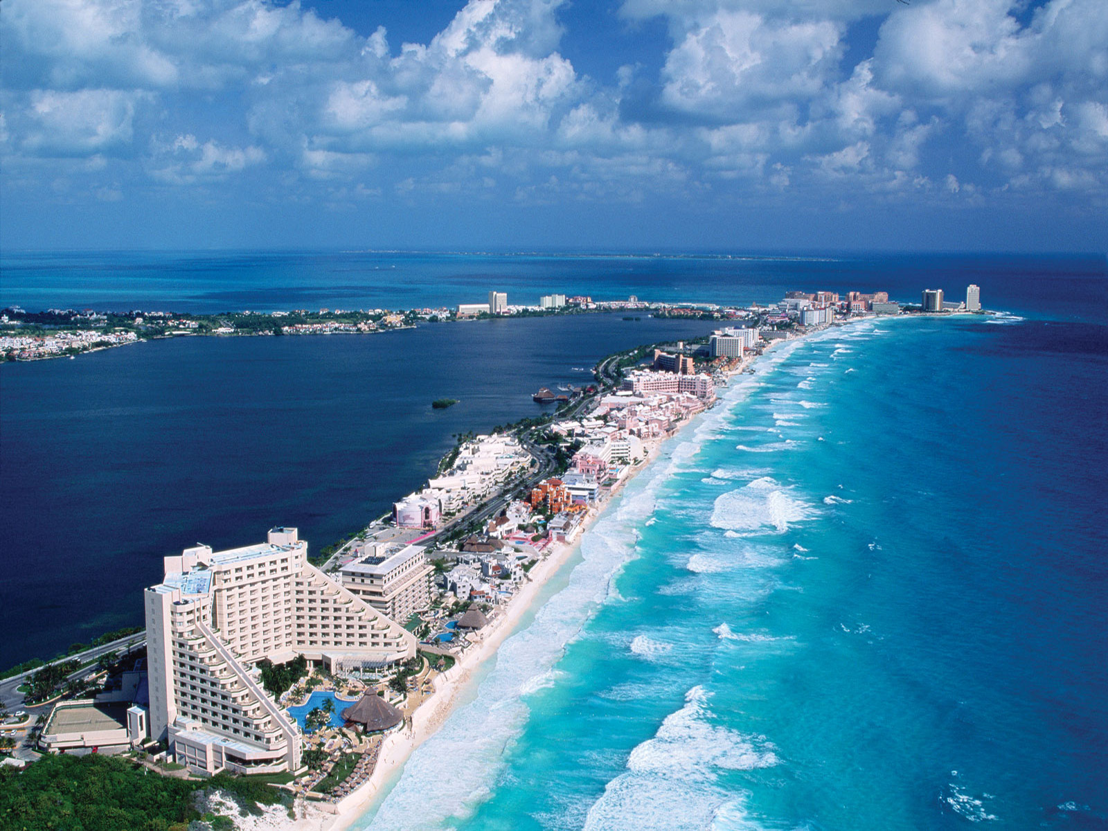 An aerial view of the Hotel Zone of Cancun, Mexico and the blue waters of the Gulf of Mexico. Hotels and tourist facilities crowd the narrow, 21-mile sandbar on the Yucatan coast, one of Mexico's most popular vacation spots. November 18, 1995 Cancun, Mexico